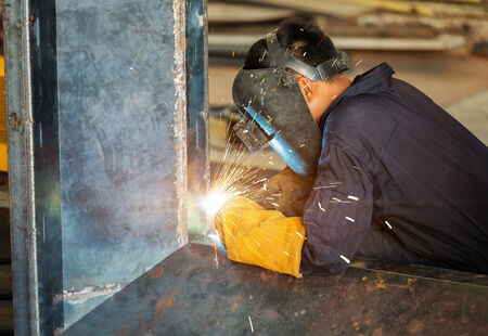 mig: worker welding construction by MIG welding Stock Photo