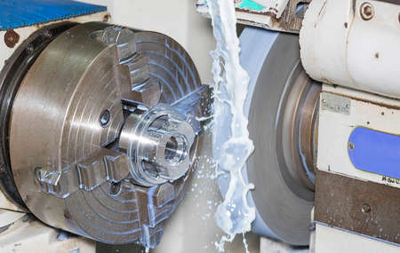operator grinding mold and die part by universal grining machine in factory_01 Standard-Bild