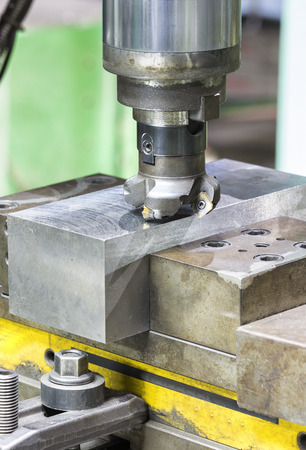 carbide: operator cutting steel surface by milling machine and milling holder Stock Photo