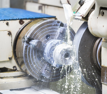 turn dial: operator grinding forging die parts by high precision grinding machine