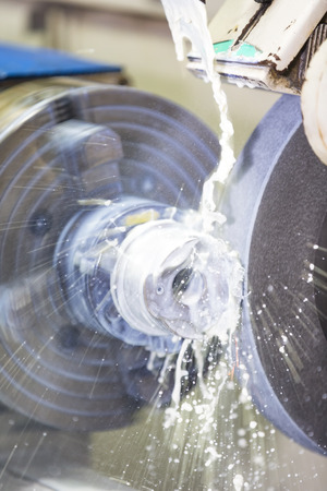 operator grinding forging die parts by high precision grinding machine