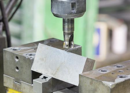 milling machine: operator cutting steel surface by milling machine and milling holder Stock Photo