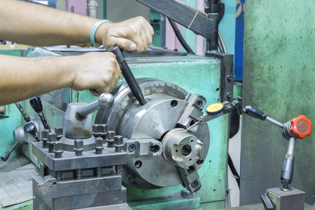 setup operator: operator setup turning part on manual lathe machine by dial gauge
