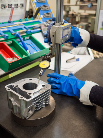 turning operation: operator inspection aluminum automotive parts by high gauge