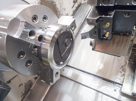 operator machining mold and die for automotive parts by high precision CNC lathe