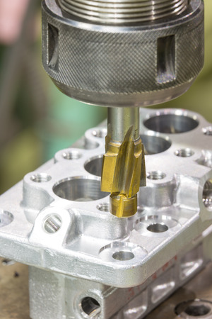 tool chuck: operator machining aluminium automotive parts by high precision machining center Stock Photo