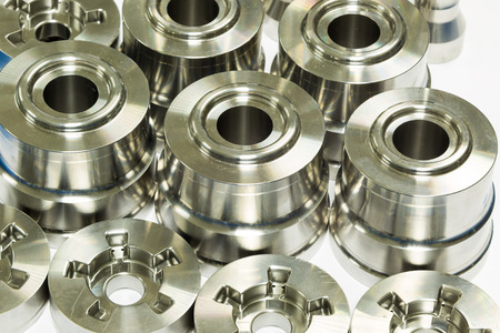 manufacture: operator inspection dimension of high precision cnc turning parts Stock Photo