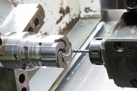 operator machining die casting machine parts by high precision CNC lathe