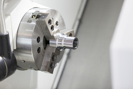affixment: automotive industrial metal work machining process by cutting tool on CNC lathe