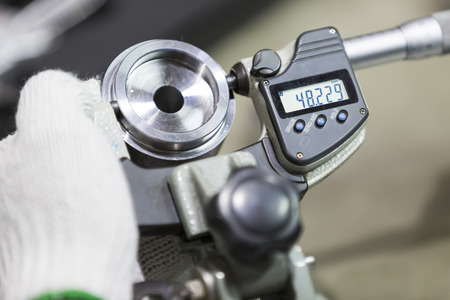 micrometer: operator inspection high precision automotive part by micrometer