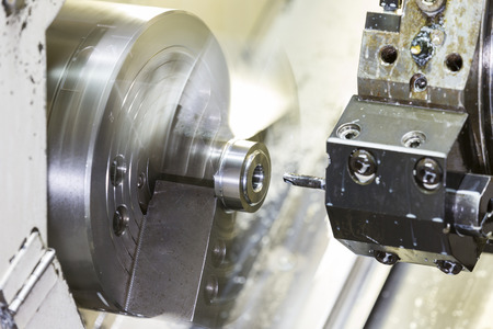 Turning high precision automotive part by cnc lathe Stock Photo