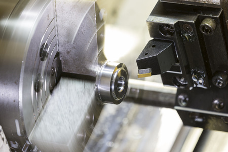 automated tooling: Turning high precision automotive part by cnc lathe Stock Photo