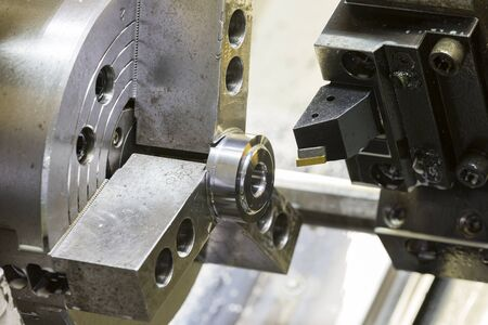 metalwork: Turning high precision automotive part by cnc lathe Stock Photo