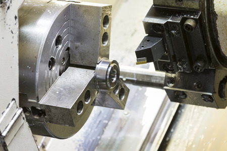 tool chuck: Turning high precision automotive part by cnc lathe Stock Photo