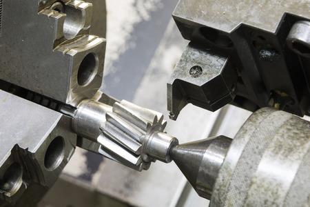 tool chuck: Operator machining automotive gear by cnc turning machine Stock Photo