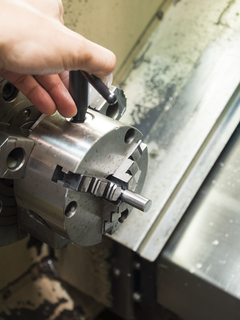 setup operator: Operator setup machining high precision mold part by cnc lathe