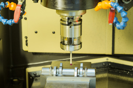 machining center: CNC machining center cutting mold by endmill cad cam and inspection on machine