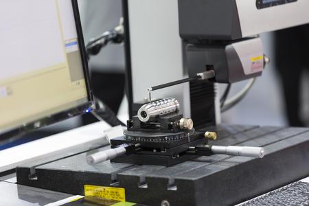 programing: inspection automotive part by contour measuring machine Stock Photo