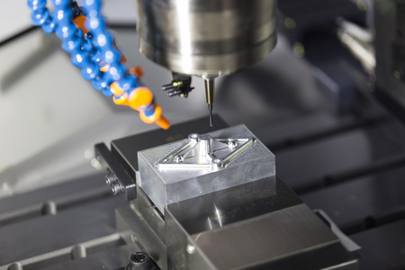 precision: machining precision part by CNC machining center Stock Photo