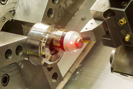 tool and die: setup cutting tool before machining high precision automotive part by CNC lathe