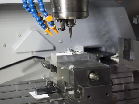 machining center: machining precision part by CNC machining center Stock Photo