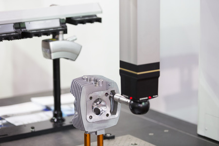 measuring: inspection automotive part dimension by CMM measuring machine
