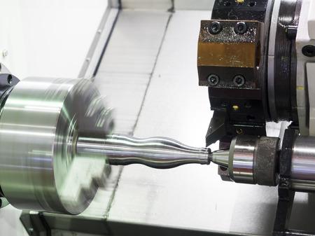 Operator machining automotive part by cnc turning machine Stock Photo