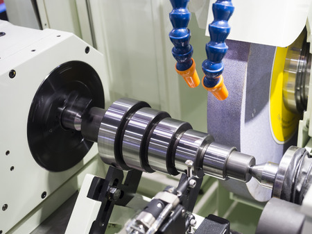 programing: operator grinding mold and die part by universal grining machine