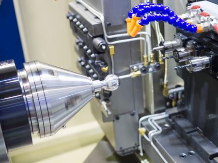 machining: Operator machining automotive part by cnc turning machine Stock Photo