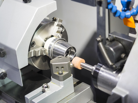 operator grinding mold and die part by universal grining machine