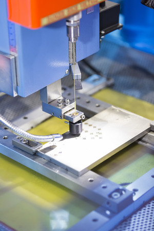 tool and die: operator use copper EDM electrod to drill precision mold and die