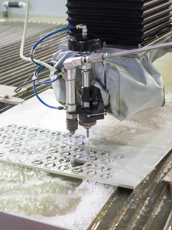 programing: waterjet metal cutting by cnc programing Stock Photo