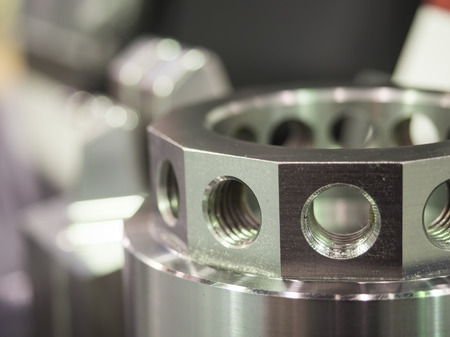 metal parts: operator inspection dimension of high precision cnc turning parts Stock Photo