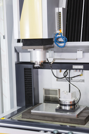 grafit: operator use graphite EDM electrod to make precision mold and die
