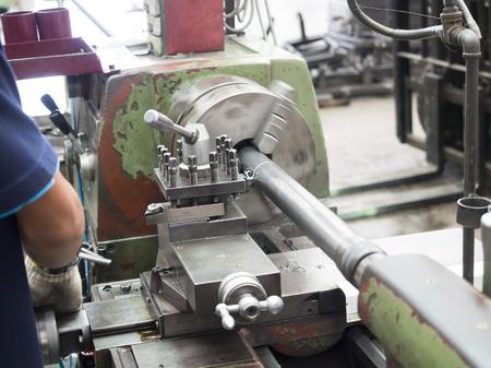machine tool: operator turning part by manual lathe machine
