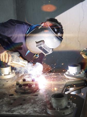 welding machine: Operator welding machine structure by electric welding Stock Photo