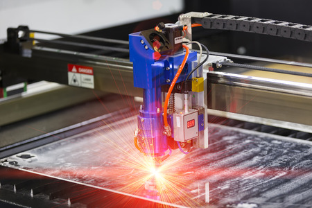 cutting metal: High precision CNC laser cutting metal sheet Stock Photo