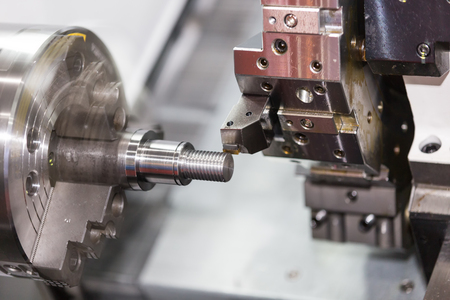 Operator machining automotive part by cnc turning machine Standard-Bild