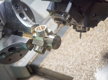 processing speed: Operator machining automotive part by cnc turning machine Stock Photo