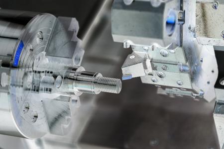 plc: Operator machining automotive part by cnc turning machine Stock Photo