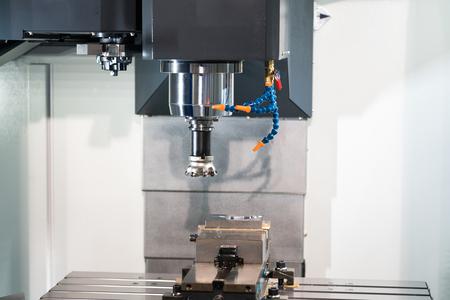 machining precision part by CNC machining center Stock fotó