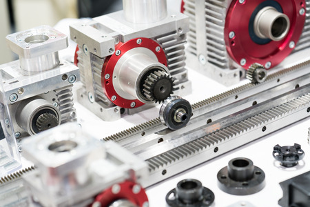 shiny car: Industrial high precision gear head and gear rack for manufacturing machine, gear box head for assembly with electric motor Stock Photo