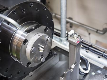 set cutting tool before machining automotive part by CNC lathe