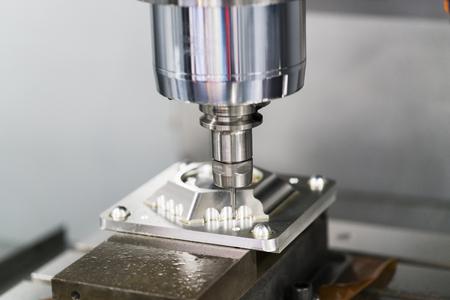 machining precision part by CNC machining center 写真素材