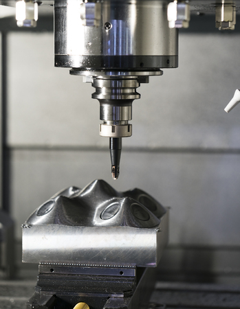 machining precision part by CNC machining center Banco de Imagens