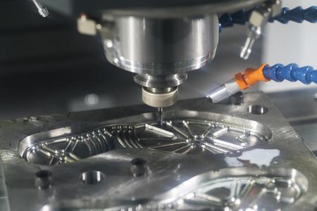 machining precision part by CNC machining center Stock Photo