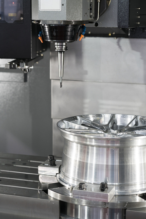 machining precision part by CNC machining center Stock Photo