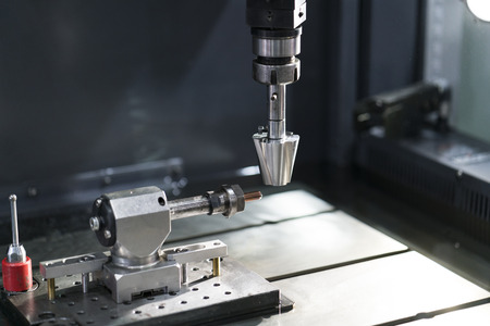 operator use copper EDM electrod to make precision mold and die, 4 axis EDM machine