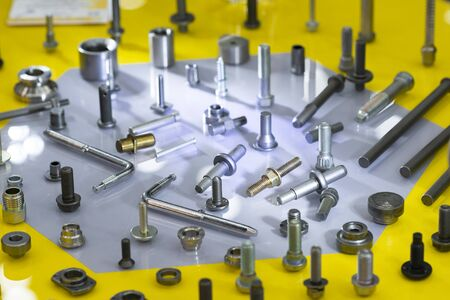screw on blue background. Industirial screw and bolt manyfacturing. screw coating with chromium zinc plating anodizing.