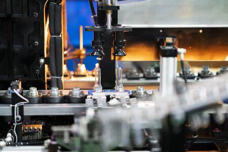 Plastic bottle hot blow manufacturing, bottle blow mold, bottle production machine Фото со стока